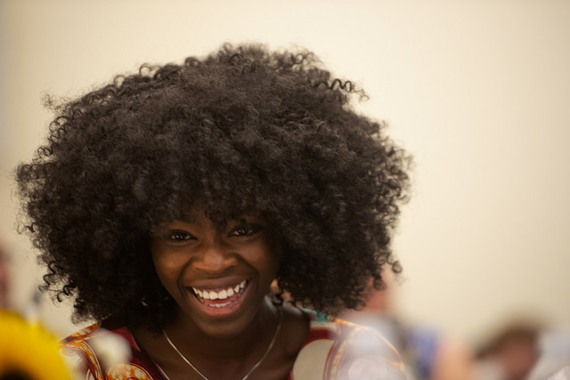 girl with afro laughing