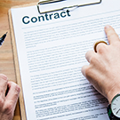 fingers pointing at a contract