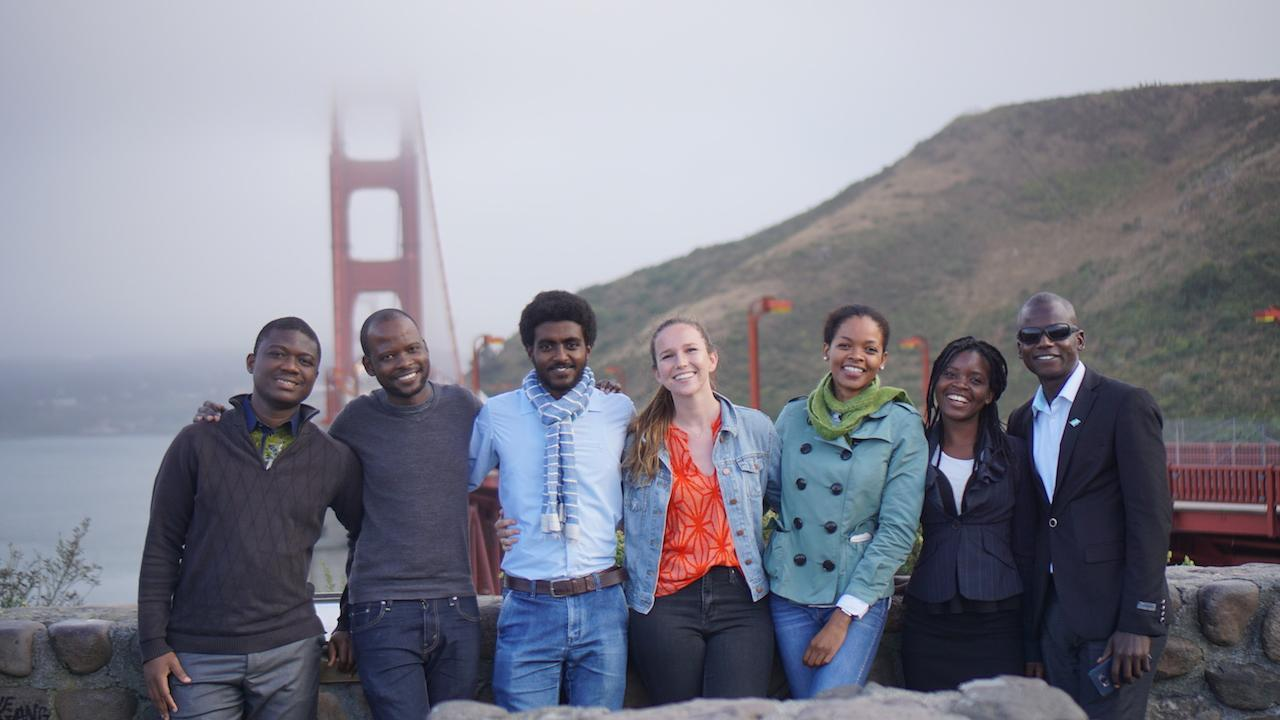 Group of people standing in front of the golden gate bridge