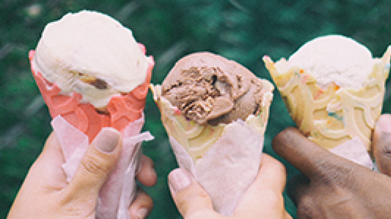 hands holding ice cream cones
