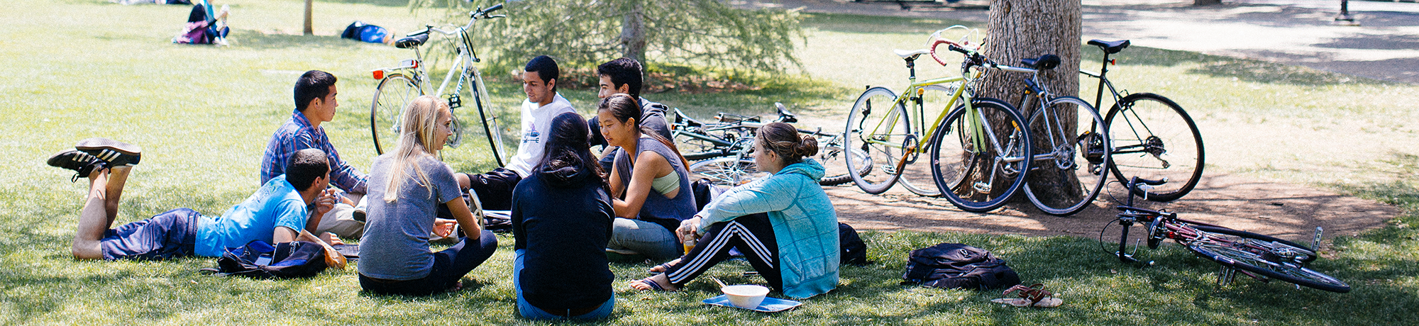 Students with bikes sitting on the Quad