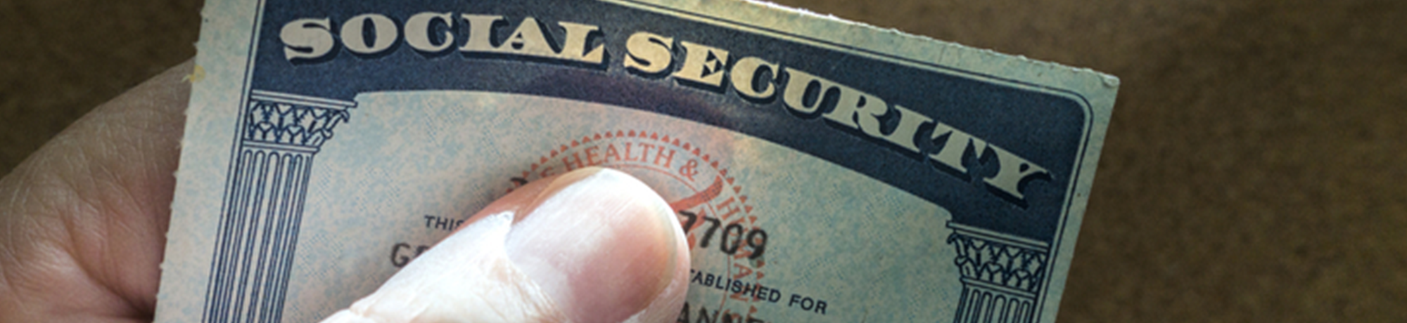hand holding a social security card
