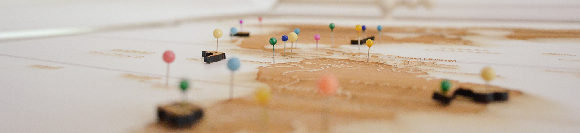 push pins in different colors on a map