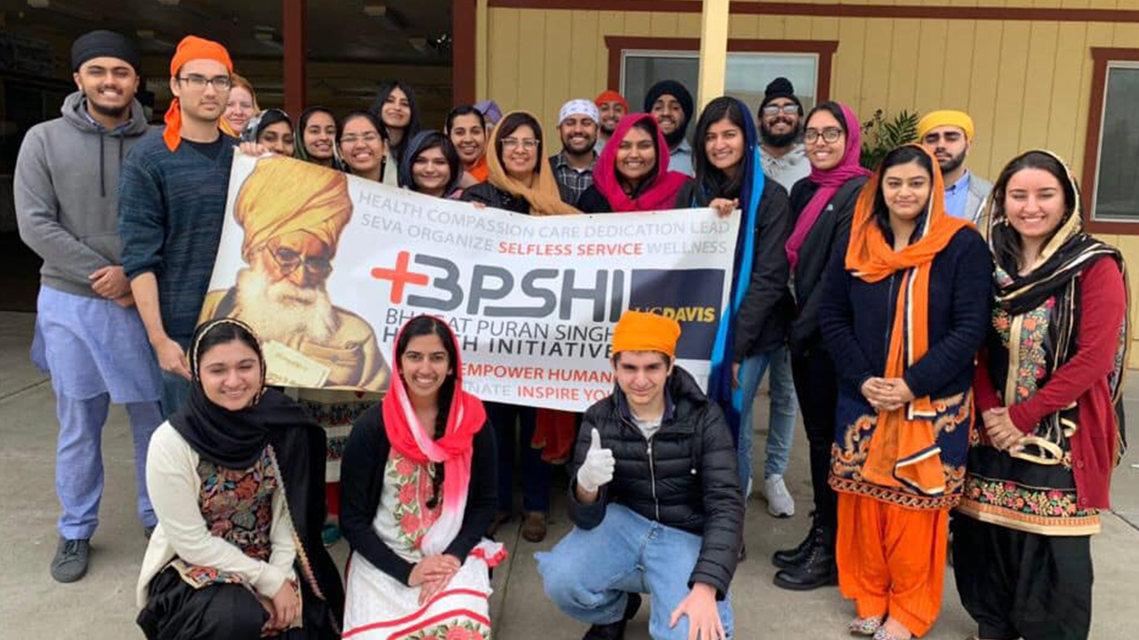 group of students standing with a sign that says BPSHI