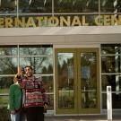 Two people take a selfie outside at the International Center